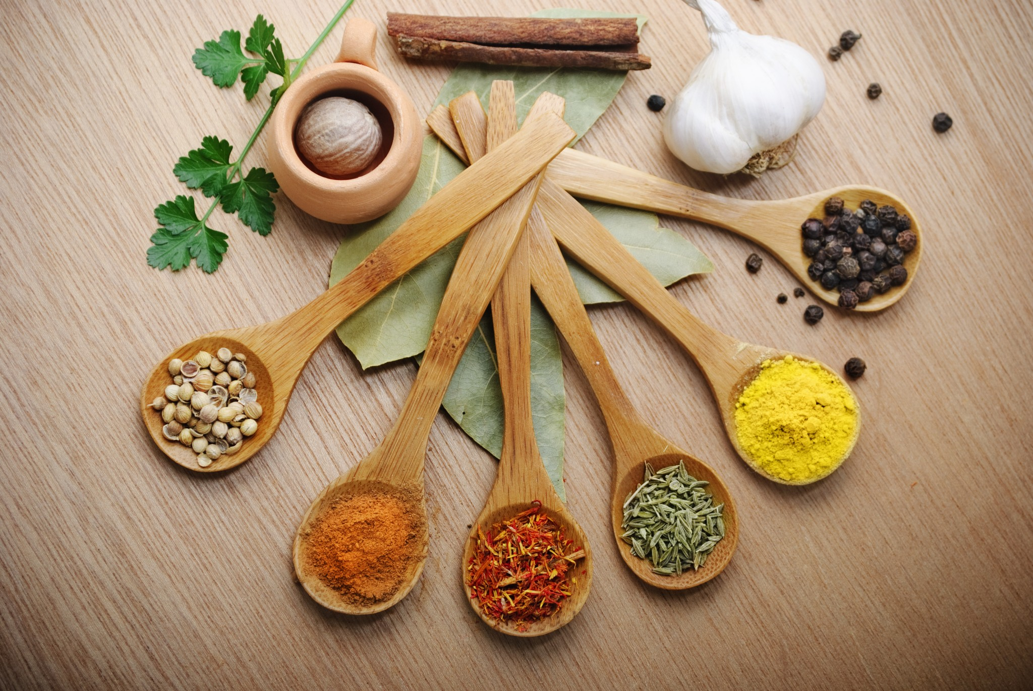 Various of spices in wooden spoon